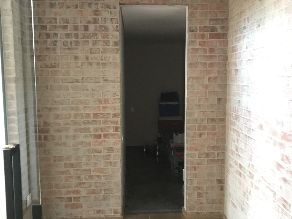 Private Cellar before installation of bespoke handmade solid-wooden floating liquor display shelves