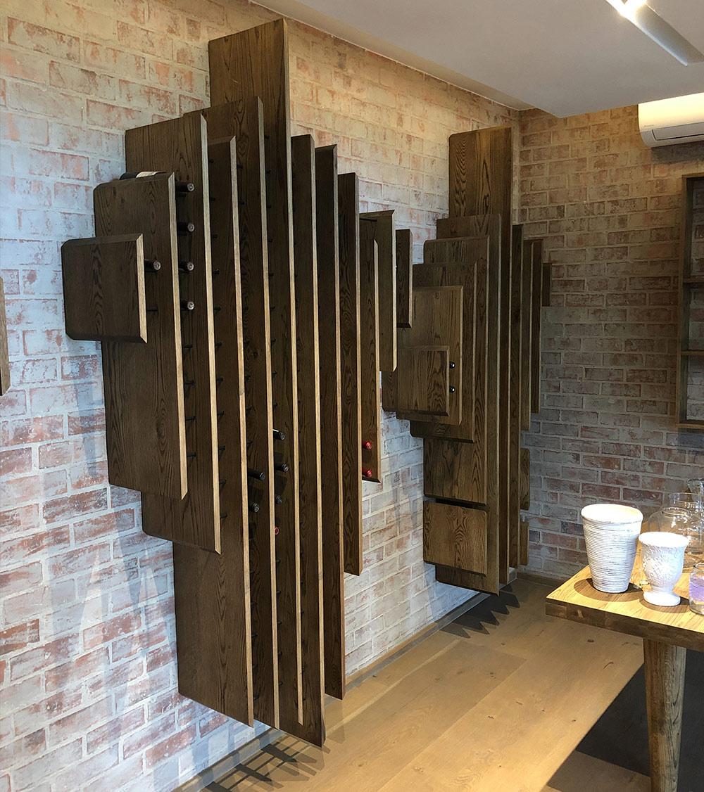 VanderNest handmade solid-wooden floating liquor bottle display shelves at a private cellar